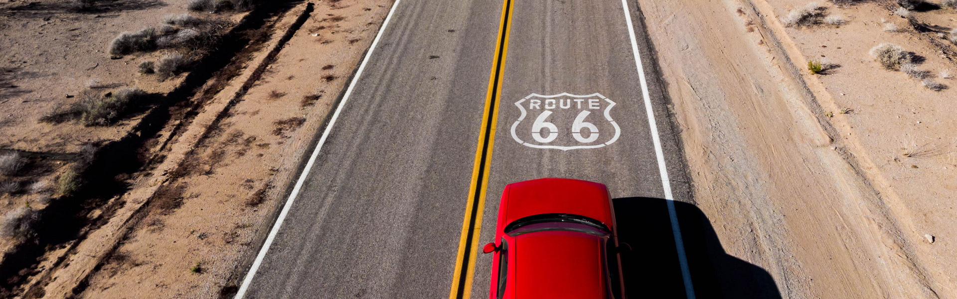 Red car on road trip down route 66
